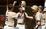 BEACON FALLS,  CT-051817JS32-Woodland's Matt Szturma (5) is congratulated by teammates Jason Claiborn  (10) and Mike Szturma (15) after blasting a two run home-run during their game against Wolcott Thursday at Woodland Regional High School in Beacon Falls. <br /> Jim Shannon Republican-American