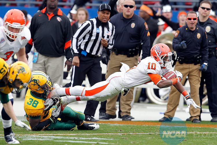 07 JAN 2012:  Brian Bell (11) of Sam Houston State dives for extra yardage against North Dakota State University during the Division I Men's FCS Football Championship held at Pizza Hut Park in Frisco, TX. North Dakota State beat Sam Houston State 17-6 to win the national title Tom Pennington/NCAA Photos