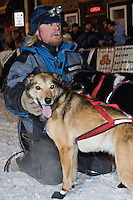 A musher calms his dogs in downtown Marquette Michigan during the start of the UP 200 Sled Dog Championship race.