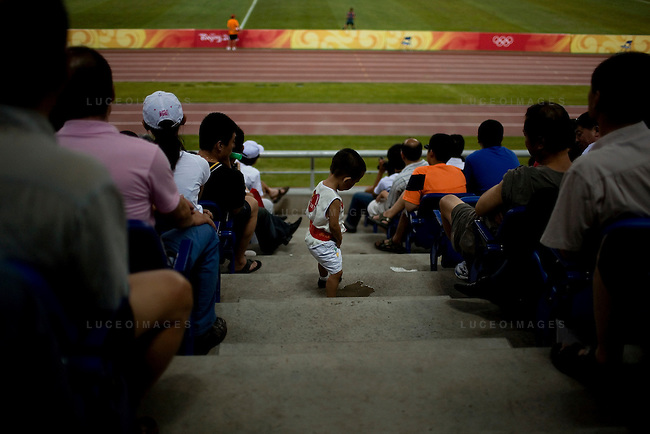 A child urinates in the stands during a football match between Brazil and Norway at the Tainjin Olympic Center Stadium in Tainjin, China on Friday, August 15, 2008.  Kevin German