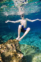 Fethiye to Kas, Turkey, October 2007. Snorkeling and swimming between the rocks is a good way to cool down on a hot day. The Blue Cruise on a wooden sailing yacht, better known as gulet, is one of the best ways to explore the Turkish Mediterranean Coast. Photo by Frits Meyst / MeystPhoto.com