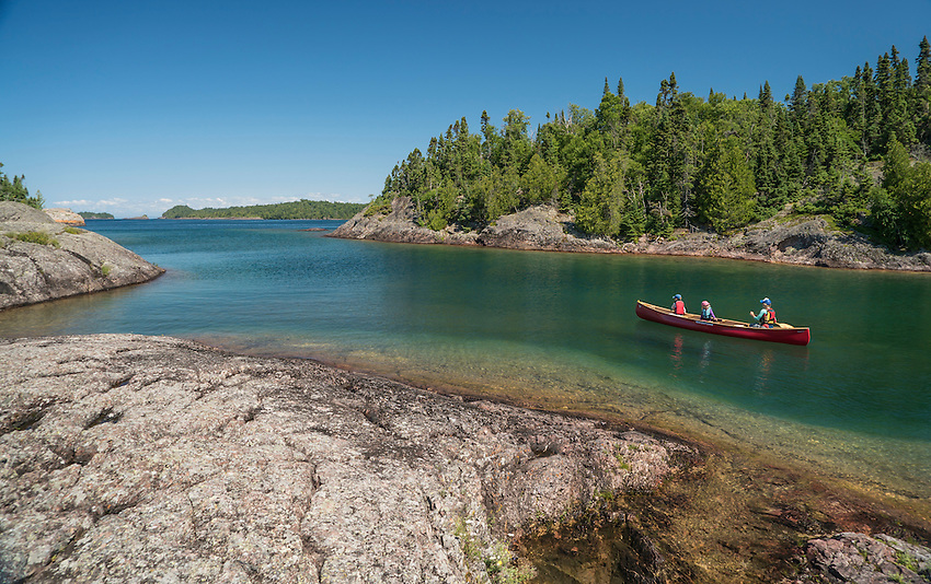 Family canoeing near Devils Warehouse Island at Lake Superior Provincial Park, Ontario, Canada.