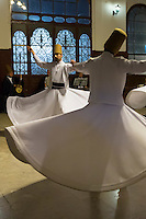 Whirling Dervish dance performance - Mevlevi Sema ceremony (whirling dervishes) with ayin music in Istanbul, Republic of Turkey