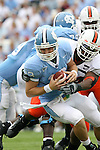 06 October 2007: North Carolina's T.J. Yates (13) is sacked by Miami's Teraz McCray. The University of North Carolina Tar Heels defeated the University of Miami Hurricanes 33-27 at Kenan Stadium in Chapel Hill, North Carolina in an Atlantic Coast Conference NCAA College Football Division I game.