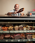 Zbigniew Gorzkowki knows what you need is a good kielbasa at Halgo European Deli & Groceries in Durham, N.C., Wednesday, September 28, 2011.
