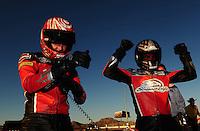 Oct. 30, 2011; Las Vegas, NV, USA: NHRA pro stock motorcycle rider Eddie Krawiec (right) celebrates after defeating teammate Andrew Hines after winning the Big O Tires Nationals at The Strip at Las Vegas Motor Speedway. Mandatory Credit: Mark J. Rebilas-