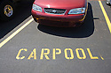 A car in a designated carpool parking space in the Palo Alto High School parking lot. Palo Alto, California, USA