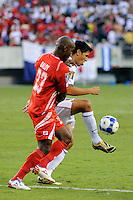 Brian Ching (11) of the United States (USA) is marked by Felipe Baloy (23) of Panama. The United States (USA) defeated Panama (PAN) 2-1 during a quarterfinal match of the CONCACAF Gold Cup at Lincoln Financial Field in Philadelphia, PA, on July 18, 2009.