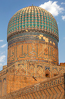General view of one of the three smaller domed buildings, Bibi-Khanym Mosque, 15th century,  Samarkand, Uzbekistan, pictured on July 17, 2010, in the afternoon. Named after the wife of Amir Timur, 14th century ruler, the mosque was constructed following his 1399 Indian campaign. It collapsed after an earthquake in 1897 and was restored in the late 20th century. Samarkand, a city on the Silk Road, founded as Afrosiab in the 7th century BC, is a meeting point for the world's cultures. Its most important development was in the Timurid period, 14th to 15th centuries. Picture by Manuel Cohen.