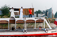 Egypt. Aswan stands on the east bank of the Nile. A passenger boat on the Nile.