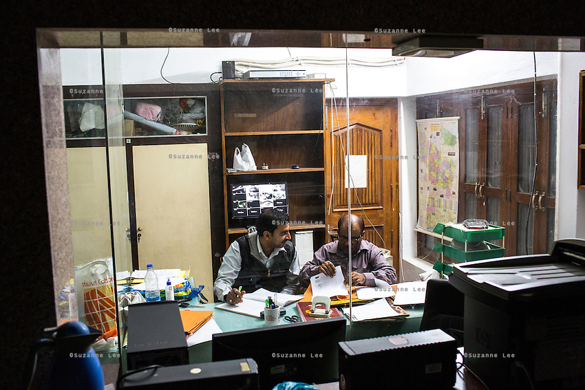Guria Swayam Sevi Sansthan staff work late into the night on Brinda's court case, in the Guria office in Varanasi, Uttar Pradesh, India on 22 November 2013.