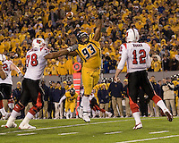 WVU defensive lineman Scooter Berry (93) tries to block a pass by Louisville quarterback Brian Brohm (12).  The West Virginia Mountaineers defeated the Louisville Cardinals 38-31 on November 08, 2007 at Mountaineer Field, Morgantown, West Virginia. .