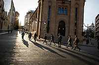 Lebanese army soldiers walk past the parliament building in Beirut, Lebanon. National elections, due to be held in June 2013, have been postponed until 2014 and a 17-month extension of parliament was voted for by politicians after they failed to agree changes to the electoral law.
