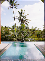 A tranquil pool graced with a statue of Buddha heralds the entrance to the property