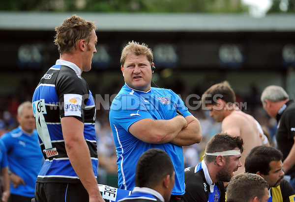 Forwards coach Neal Hatley has a word with Ben Skirving at half-time. Pre-season friendly match, between Bath Rugby and London Welsh on August 11, 2012 at the Recreation Ground in Bath, England. Photo by: Patrick Khachfe / Onside Images