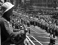 Workman on 2nd story ledge watches U.S President  Lyndon B. Johnson parade down Market Street in San Francisco, California June 19,1964. (photo by Ron Riesterer)