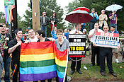N.C. Pride Parade participants stand next to parade protesters in Durham on Saturday, Sept. 29, 2012, at the corner of Main and Broad streets.