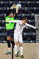 Maryland Terrapins goalkeeper Zack Steffen (99) and Notre Dame Fighting Irish midfielder Nick Besler (8). The Notre Dame Fighting Irish defeated the Maryland Terrapins 2-1 during the championship match of the division 1 2013 NCAA  Men's Soccer College Cup at PPL Park in Chester, PA, on December 15, 2013.