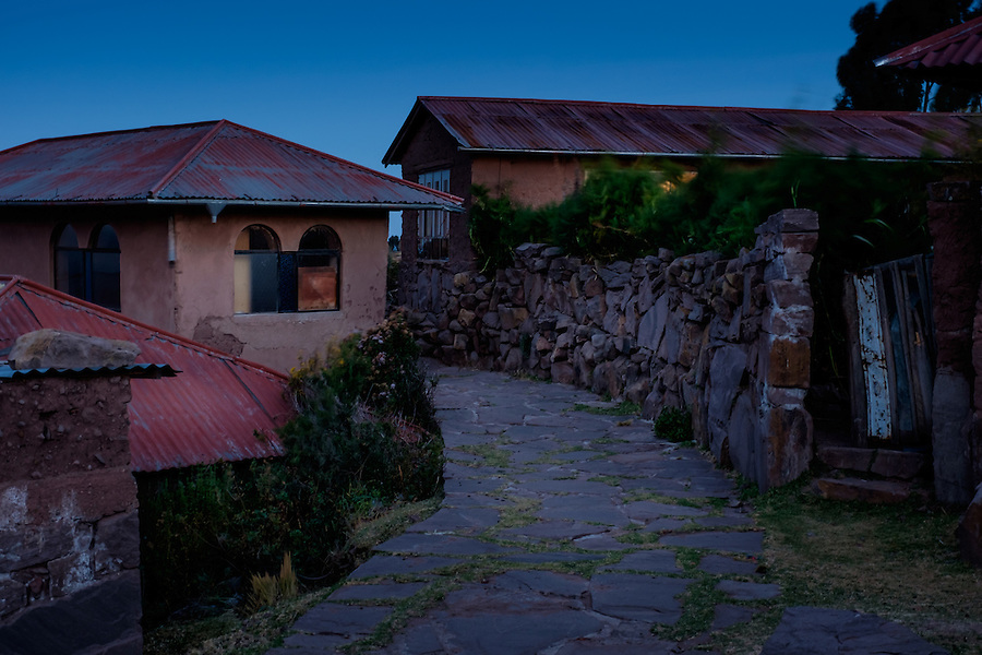 PUNO, PERU - CIRCA OCTOBER 2015: Typical houses of the Island of Taquile in Lake Titicaca at night.