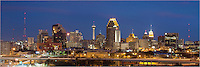 On a pleasant spring night, the San Antonio skyline rises into the sky. As lights begin to flicker on, folks head home from a long day of work. This panorama of the city looks relatively south.