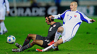 Johnathan Bornstein (12) slides for the ball ahead of Vladimir Weiss (7). Slovakia defeated the US Men's National Team 1-0 at the Tehelne Pole in Bratislava, Slovakia on November 14th, 2009.