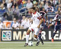D.C. United defender Dejan Jakovic (5) dribbles at midfield as New England Revolution forward Dimitry Imbongo (92) closes. In a Major League Soccer (MLS) match, the New England Revolution (blue) defeated D.C. United (white), 2-1, at Gillette Stadium on September 21, 2013.