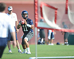 Ole Miss' Barry Brunetti (11) throws the ball during a drill at football practice in Oxford, Miss. on Sunday, August 7, 2011.