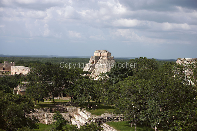 The Temple of the Magician or House of the Dwarf with the Nunnery Quadrangle, c. 900 AD, Puuc architecture, Uxmal late classical Mayan site, flourished between 600-900 AD, Yucatan, Mexico Picture by Manuel Cohen