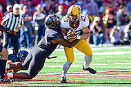 College Park, MD - OCT 15, 2016: Minnesota Golden Gophers running back Shannon Brooks (23) is tackled by Maryland Terrapins linebacker Jermaine Carter Jr. (23) during game between Maryland and Minnesota at Capital One Field at Maryland Stadium in College Park, MD. (Photo by Phil Peters/Media Images International)