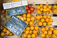 Local produce red tomatoes and yellow tomatoes, at farmers market in Normandy, France