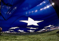 A giant flag is pictured during national anthem before the game during 77th Annual Allstate Sugar Bowl Classic at Louisiana Superdome in New Orleans, Louisiana on January 4th, 2011.  Ohio State defeated Arkansas, 31-26.