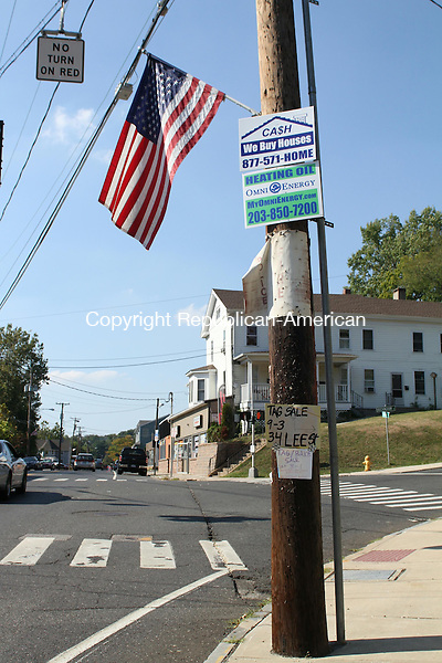 WATERTOWN, CT, 18 September 2015 - 091815HOLW05 - Signs on telephone poles, like these on Main Street in Oakville are prohibited under Watertown's sign regulations. Laraine Weschler