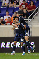 Davide Chiumiento (20) of the Vancouver Whitecaps celebrates scoring with Eric Hassli (29). The New York Red Bulls and the Vancouver Whitecaps played to a 1-1 tie during a Major League Soccer (MLS) match at Red Bull Arena in Harrison, NJ, on September 10, 2011.