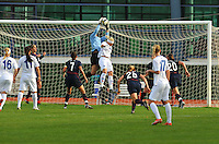 USA goalkeeper, Hope Solo, snatches the ball away from an Iceland attacker.  The USWNT defeated Iceland (2-0) at Vila Real Sto. Antonio in their opener of the 2010 Algarve Cup on February 24, 2010.