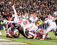 The tenth ranked South Carolina Gamecocks host the 6th ranked Clemson Tigers at Williams-Brice Stadium in Columbia, South Carolina.  USC won 31-17 for their fifth straight win over Clemson.  Clemson players defend the goal line.