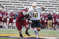 Towson, MD - May 6, 2017: Towson Tigers Alex Woodall (41) fights for the groundball during game between Towson and UMASS at  Minnegan Field at Johnny Unitas Stadium  in Towson, MD. May 6, 2017.  (Photo by Elliott Brown/Media Images International)