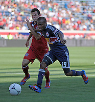 New York midfielder Dane Richards (19) battles for the ball with Chicago midfielder Marco Pappa (16).  The Chicago Fire defeated the New York Red Bulls 3-1 at Toyota Park in Bridgeview, IL on June 17, 2012.