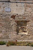 Isola di Pianosa. Pianosa Island. .Le targhe stradali dedicate ai morti ammazzati dalla mafia..The street signs dedicated to the dead killed by the Mafia..Via Rocco Chinnici..