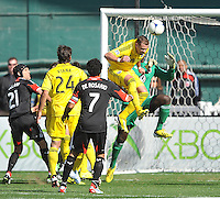 Josh Willimas (3) of the Columbus Crew heads the ball against Bill Hamid (28) of D.C. United to score in the minute 15th. The Columbus Crew defeated D.C. United  2-1, at RFK Stadium, Saturday March 23, 2013.