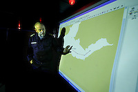 Captain of the Coastguard vessel KV Svalbard, Morten Joergensen, gives a brief during a rescue opration. The ship patrols the northermost waters of Norway, including around the islands that she is named after. The main task is inspecting fishing boats, but she also performs search and rescue missions, and environmental monitoring.