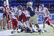 Annapolis, MD - December 3, 2016: Temple Owls wide receiver Adonis Jennings (17) is pushed out of bounds by Navy Midshipmen linebacker Micah Thomas (44) during game between Temple and Navy at  Navy-Marine Corps Memorial Stadium in Annapolis, MD.   (Photo by Elliott Brown/Media Images International)