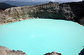 Colorful crater lake on Kelimutu Volcano, Flores Island, Indonesia. The lake is highly acidic due to active underwater fumarole activity and is turquoise in color.