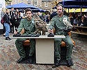 "Cast members, Lewis Howard (as Callum) and  Ben Dyson (as Paddy) from ""Swivelhead"", Pipeline Theatre's new play, meet a barn owl and an eagle owl in the courtyard at the Pleasance. ""Swivelhead"" runs from 3rd - 29th August in Pleasance 2."