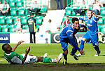 Hibs v St Johnstone.....30.04.11.Kevin Moon celebrates his late goal as Francis Dickoh lies on the pitch dejected.Picture by Graeme Hart..Copyright Perthshire Picture Agency.Tel: 01738 623350  Mobile: 07990 594431