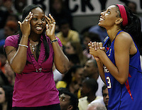 Detroit players Cheryl Ford (L) and Plenette Pierson (23) celebrate their pending victory during Game 2 of the WNBA Finals between the Detroit Shock and the San Antonio Silver Stars, Oct. 3, 2008, at the AT&T Center in San Antonio. Detroit won 69 - 61 to go up 2 - 0 in the best-of-five series. (Darren Abate/pressphotointl.com)