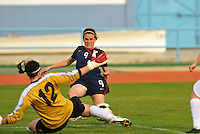 Heather O'Reilly shoots vs. Iceland goalkeeper, Gudbjorg Gunnarsdottir.  The USWNT defeated Iceland (2-0) at Vila Real Sto. Antonio in their opener of the 2010 Algarve Cup on February 24, 2010.