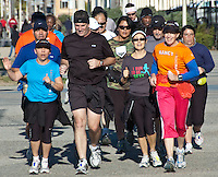 The LA Roadrunners jog along the Santa Monica Boardwalk on Saturday, December 24, 2011.