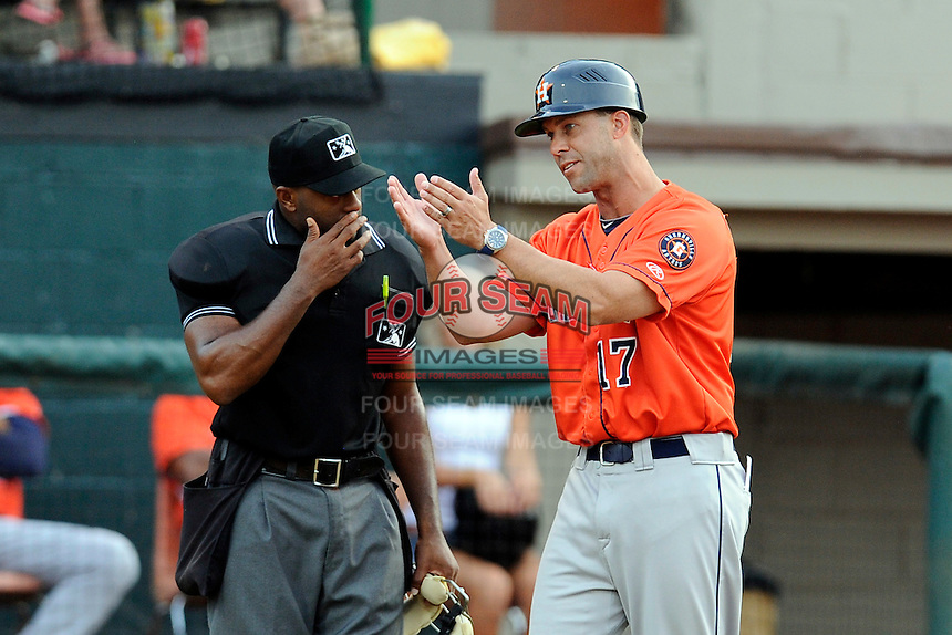Manager Josh Bonifay (17) of the Greeneville Astros discusses a call with home plate umpire C.J. Davis in a game against the Bristol Pirates on Saturday, July 26, 2014, at DeVault Memorial Stadium in Bristol, Virginia. Greeneville won, 2-1 in Game 1 of a doubleheader. (Tom Priddy/Four Seam Images)