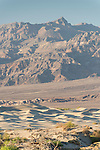 Death Valley National Park, California; a view of the Mesquite Flat Sand Dunes with the Amargosa mountain range in the background, in late afternoon sun and shadows
