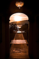 Scenic view of Udaipur's Lake Pichola at sunrise from a doorway in the Oberoi Udaivilas Palace Hotel. (Photo by Matt Considine - Images of Asia Collection)